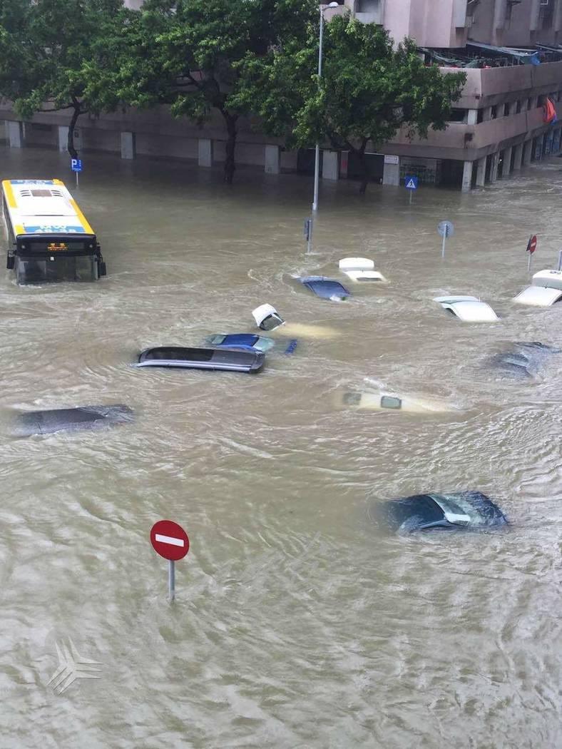 Vehicles are submerged Aug. 23, 2017, in a street in Macau after Typhoon Hato. TDM Teledifusao de Macau
