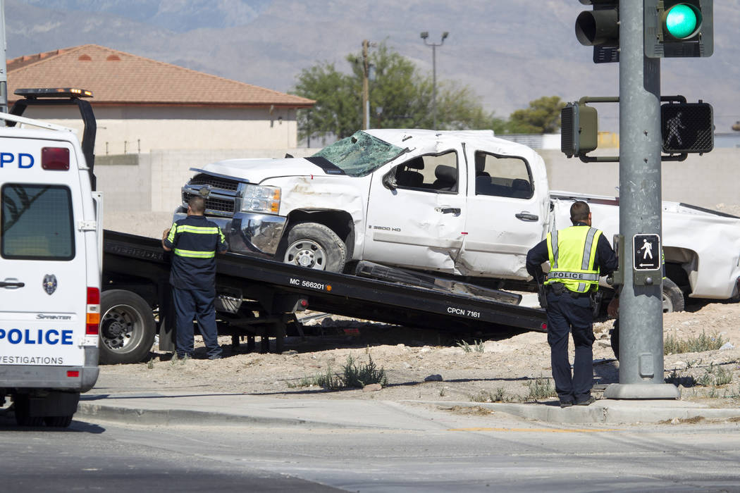 A tow truck driver loads a wrecked pickup truck involved in a fatal crash near the intersection of Cheyenne Avenue and Clayton Street on Friday, July 28, 2017, in North Las Vegas. (Richard Brian/L ...