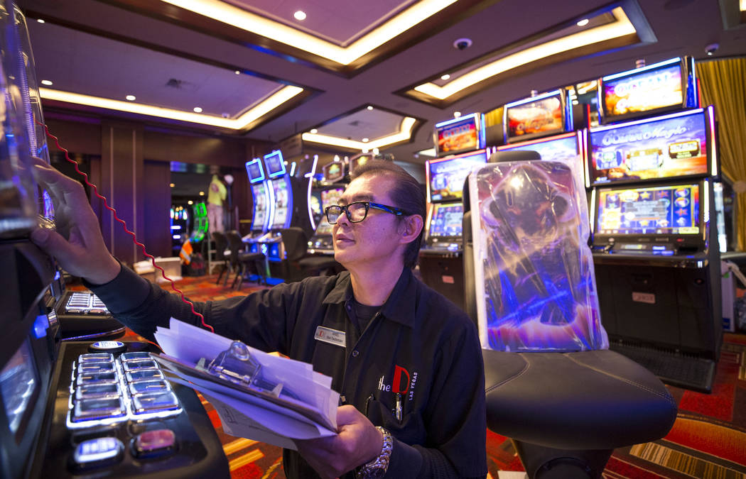 Slot technician Ariel Talosig verifies functionality on a new slot machine during renovations at the Golden Gate hotel-casino on Thursday, Aug. 25, 2017, in downtown Las Vegas. Richard Brian Las V ...