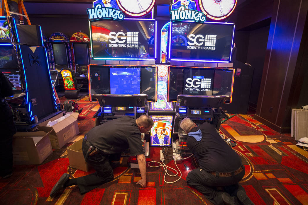 Technicians troubleshoot the networking on a pair of slot machines during renovations at the Golden Gate hotel-casino on Thursday, Aug. 25, 2017, in downtown Las Vegas. Richard Brian Las Vegas Rev ...