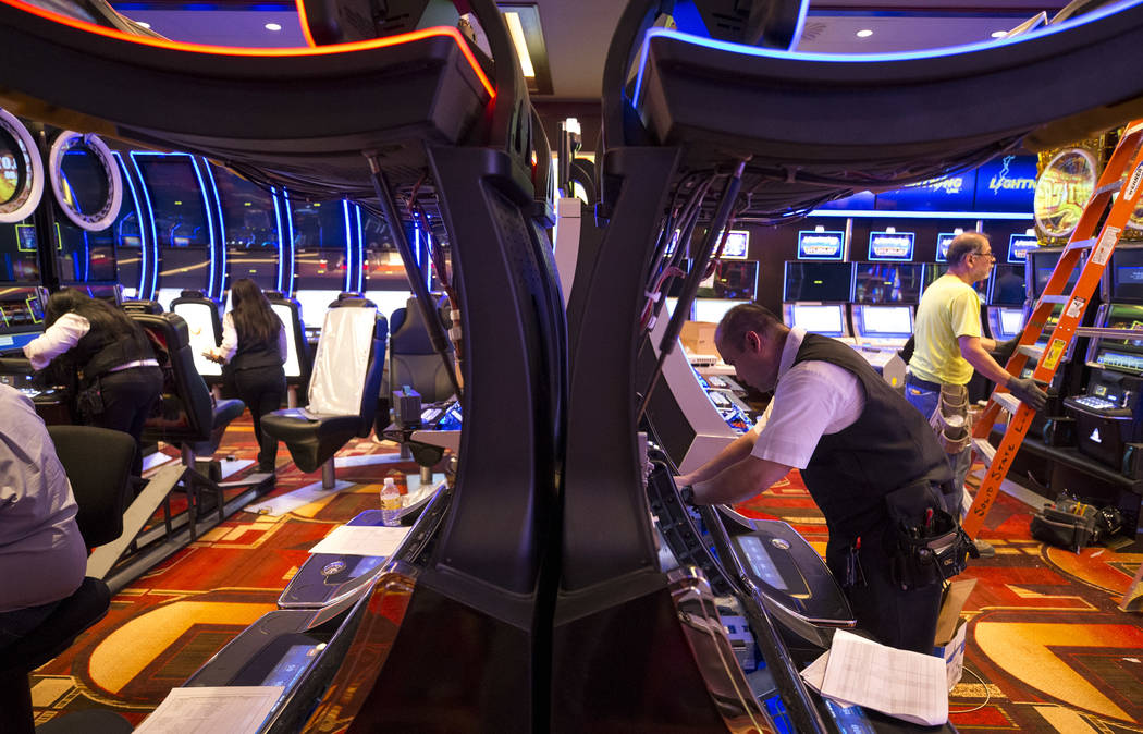 Slot attendant Eric Montoya adds paper to slot machines during renovations at the Golden Gate hotel-casino on Thursday, Aug. 25, 2017, in downtown Las Vegas. Richard Brian Las Vegas Review-Journal ...