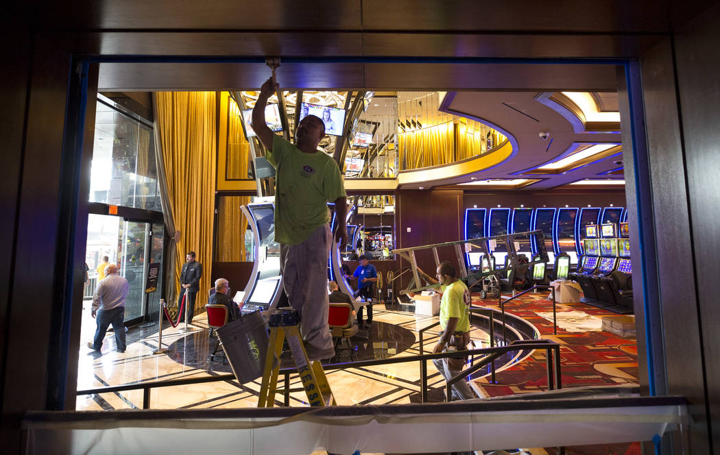 A painter touches up a wooden frame in the new casino entrance during renovations at the Golden Gate hotel-casino on Thursday, Aug. 25, 2017, in downtown Las Vegas. Richard Brian Las Vegas Review- ...