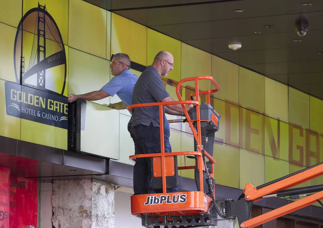 Workers install a monitor display above the outdoor bar during renovations at the Golden Gate hotel-casino on Thursday, Aug. 25, 2017, in downtown Las Vegas. Richard Brian Las Vegas Review-Journal ...