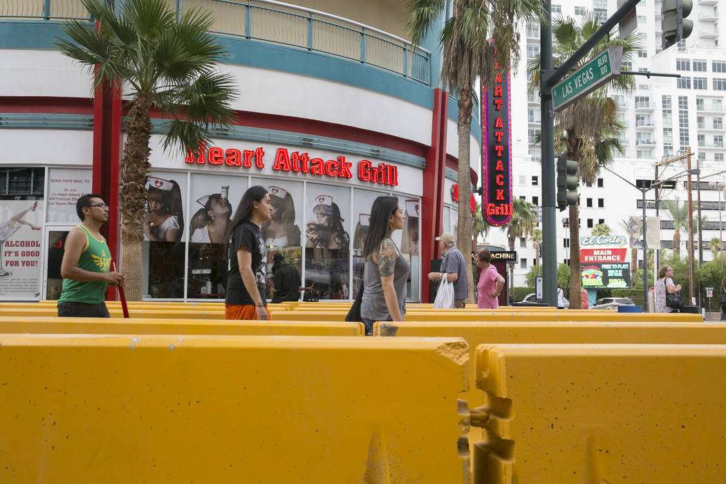 Pedestrians walk through temporary barriers at the entrance of the Fremont Street Experience in Las Vegas, on Wednesday, Aug. 23, 2017.  Gabriella Angotti-Jones Las Vegas Review-Journal @gabriella ...