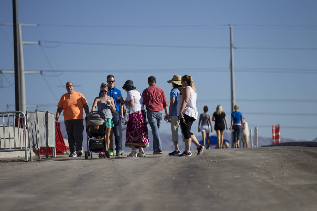 People walk a portion of the new Martin Luther King Boulevard, which is being built as part of Project Neon in Las Vegas, on Saturday, Aug. 26, 2017. Erik Verduzco Las Vegas Review-Journal @Erik_V ...