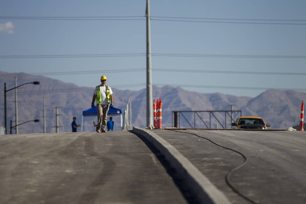 Peter Weiss, utilities manager, walks on the new Martin Luther King Boulevard, between Bearden Drive and Ellis Avenue, which is being built as part of Project Neon in Las Vegas, on Saturday, Aug.  ...