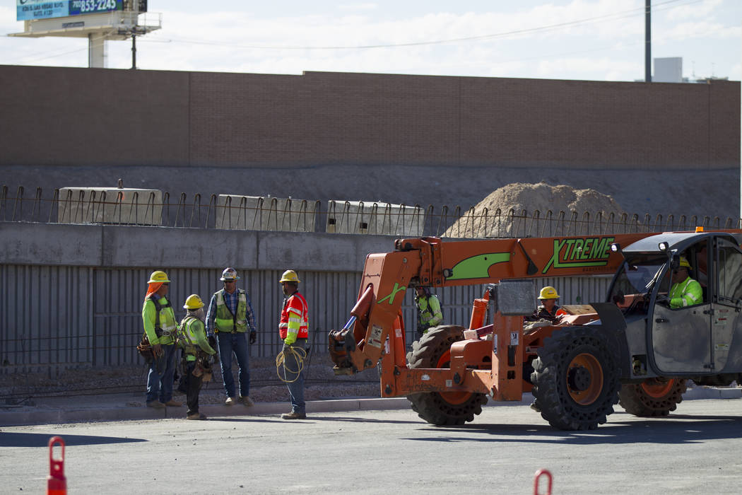 Workers at the construction site of the new portion of Martin Luther King Boulevard at Ellis Avenue, which is being built as part of Project Neon in Las Vegas, on Saturday, Aug. 26, 2017. Erik Ver ...