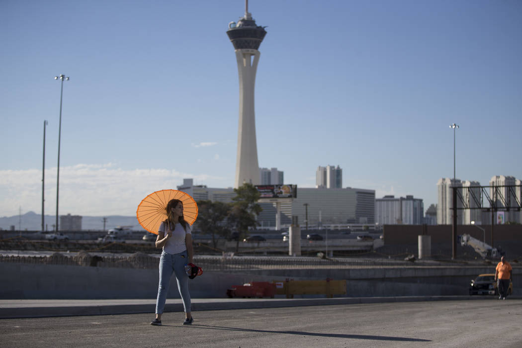 Mirella Garcia of Las Vegas walks a portion of the new Martin Luther King Boulevard, which is being built as part of Project Neon in Las Vegas, on Saturday, Aug. 26, 2017. Erik Verduzco Las Vegas  ...