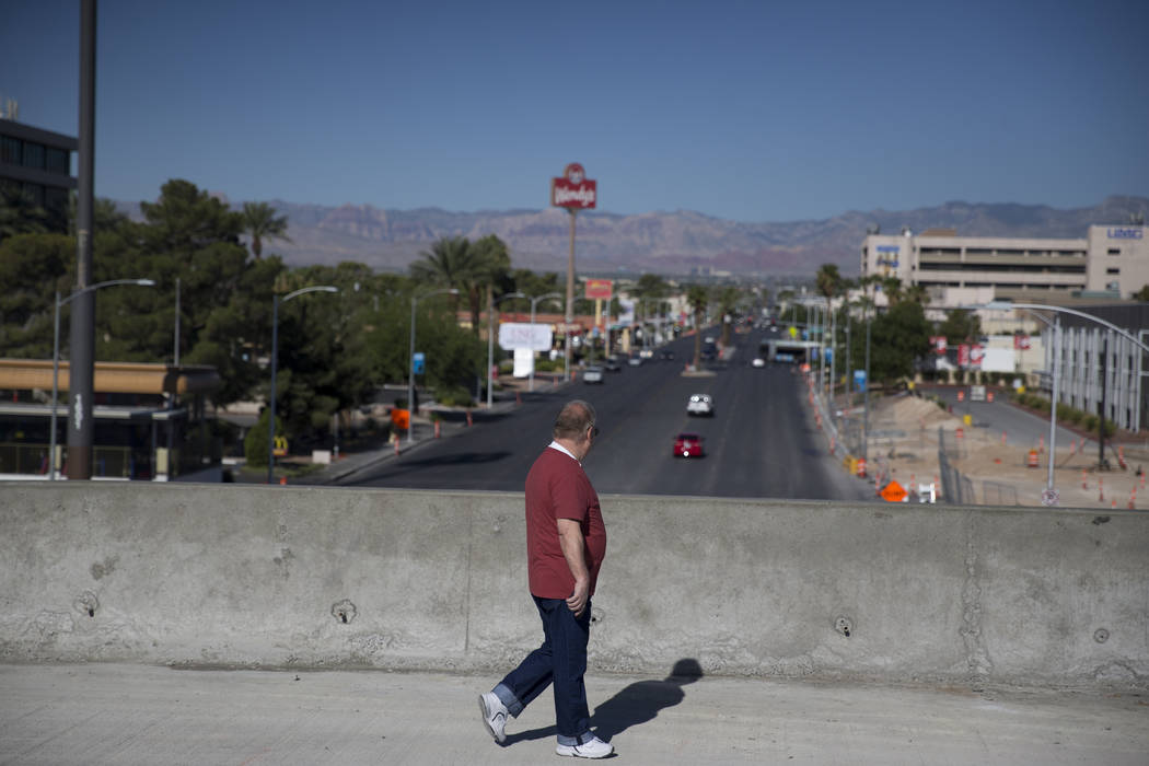 A man who declined to be identified walks a portion of the new Martin Luther King Boulevard, which is being built as part of Project Neon, in Las Vegas, on Saturday, Aug. 26, 2017. Erik Verduzco L ...