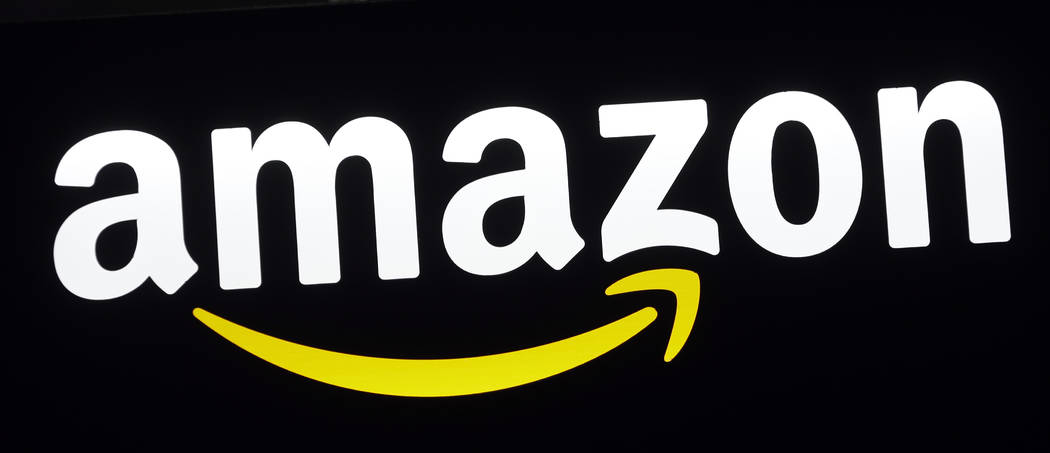 This Monday, Aug. 7, 2017, file photo shows an Amazon sign at a store in Hialeah, Fla. (AP Photo/Alan Diaz, File)