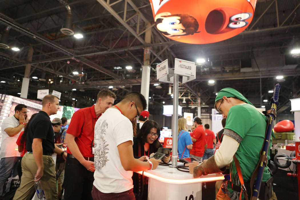 Metroid: Samus Returns is being tested on a Nintendo 3DS handheld game console during the 2017 GameStop Expo at the Sands Expo and Convention Center, Sunday, Aug. 27, 2017 . Elizabeth Brumley Las  ...