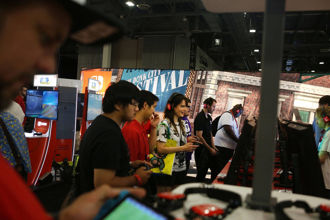 Attendees try the games during the 2017 GameStop Expo at the Sands Expo and Convention Center, Sunday, Aug. 27, 2017 . Elizabeth Brumley Las Vegas Review-Journal