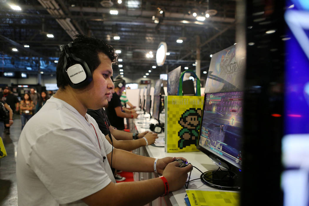Luis Vasquez tests Dissidia Final Fantasy NT, a fighting game for the PlayStation 4 during the 2017 GameStop Expo at the Sands Expo and Convention Center, Sunday, Aug. 27, 2017 . Elizabeth Brumley ...