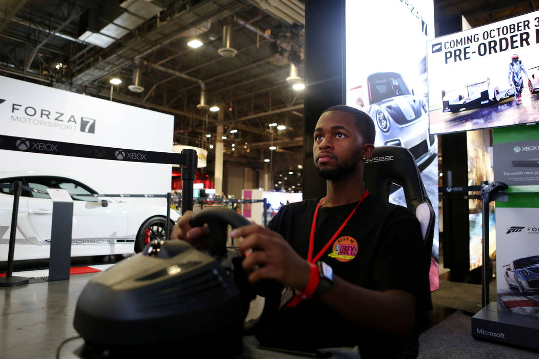 Attendee of the 2017 GameStop Expo Timothy Barnes plays on the Xbox One X, a new Video Game Console that will be available November 7, 2017, during the 2017 GameStop Expo at at the Sands Expo and  ...