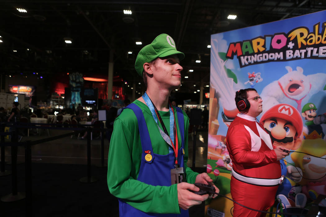 Frank Beardsley, left, and Matthew Herring test Mario + Rabbids Kingdom Battle, an upcoming video game for the Nintendo Switch during the 2017 GameStop Expo at the Sands Expo and Convention Center ...