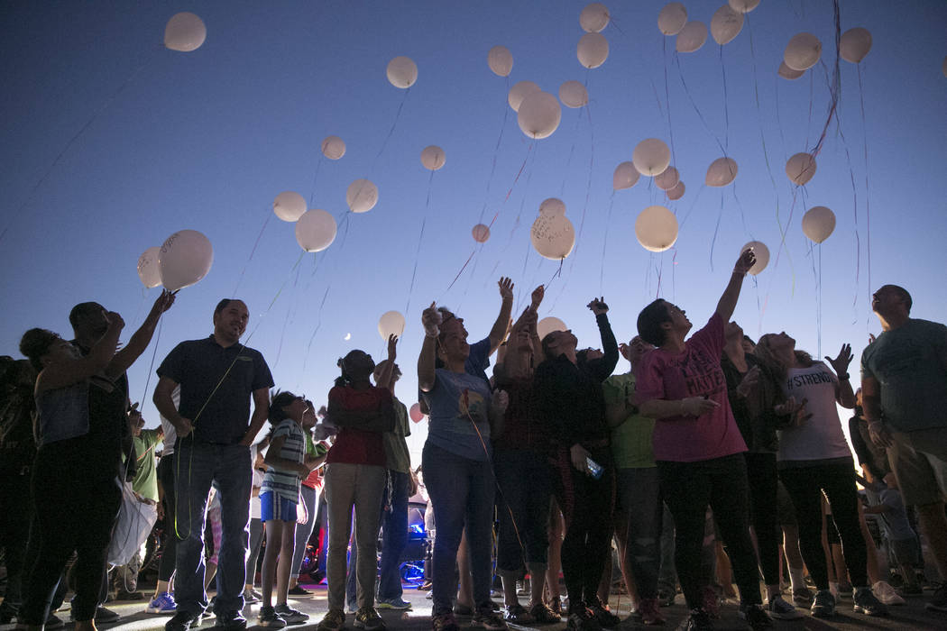 Volunteers and family of Daniel Aldape release balloons during a free dinner event in memory of Daniel Aldape in Las Vegas, on Thursday, Aug. 24, 2017.  Gabriella Angotti-Jones Las Vegas Review-Jo ...