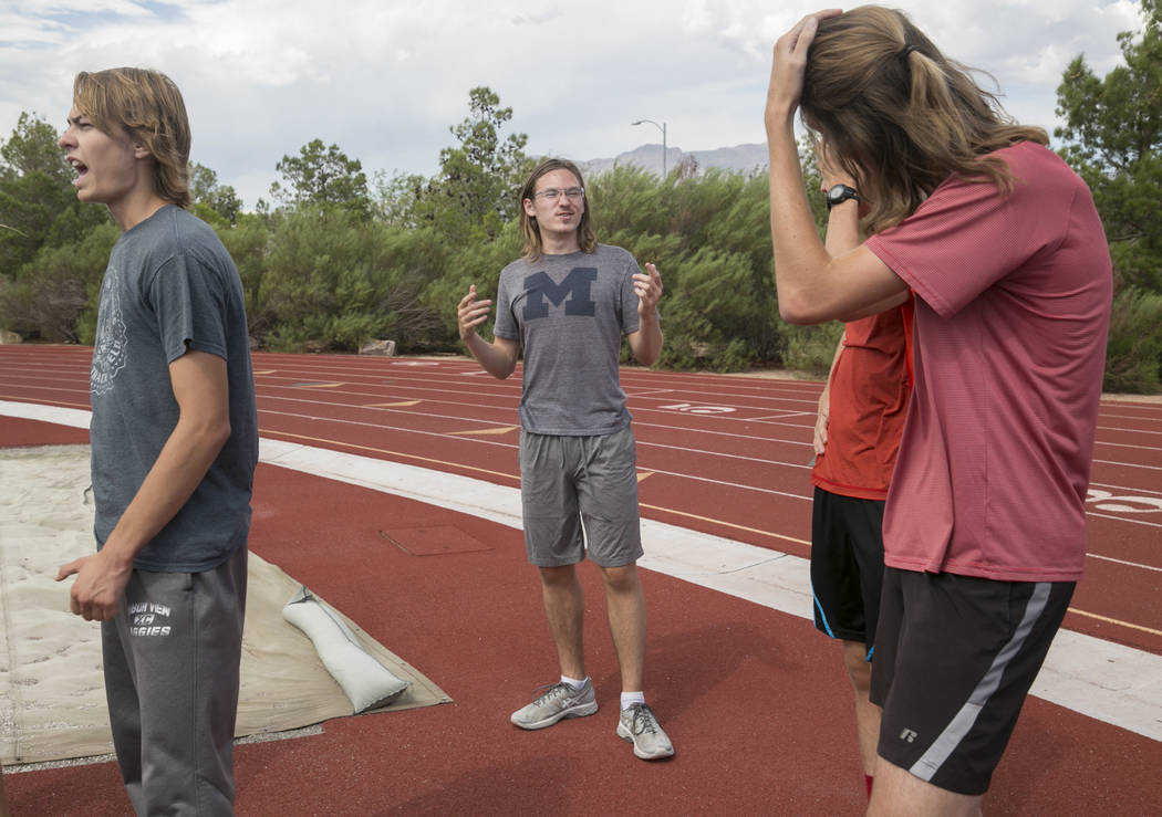 Arbor View varsity's Ian Jackson, center, who was a  first-team all-state cross country runner last year, talks to his teammates during practice at Arbor View High School in Las Vegas, on Tuesday, ...