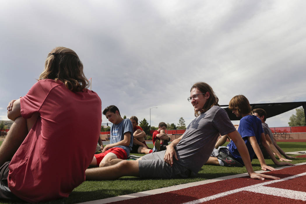 Arbor View varsity's Ian Jackson, center, who was a  first-team all-state cross country runner last year, stretches with his teammates during practice at Arbor View High School in Las Vegas, on Tu ...