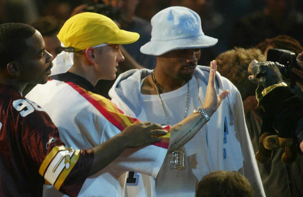 Eminem waves his hand in the face of Triumph, the comic dog, after Triumph involved Eminem in commentary about Moby during the MTV Video Music Awards at New York's Radio City Music Hall Thursday,  ...