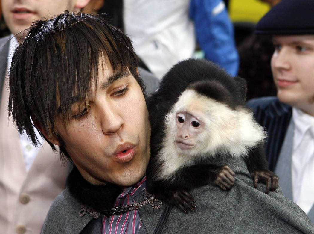 Pete Wentz, from the group Fall Out Boy, arrives with a monkey at the 2006 MTV Video Music Awards in New York, on Thursday, Aug. 31, 2006.  (AP Photo/Jason DeCrow)