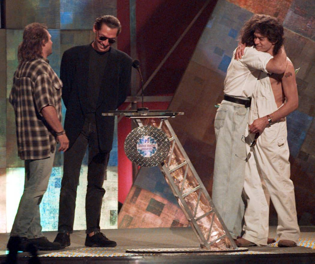 Former Van Halen bandmates David Lee Roth and Eddie Van Halen, right, embrace as they are reunited onstage at the MTV Video Music Awards in New York Wednesday, Sept. 4, 1996.  Bandmates  Michael A ...