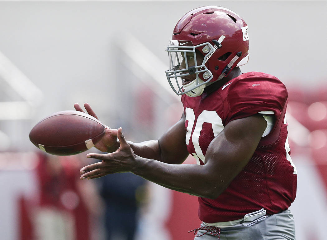 FILE - In this Saturday, Aug. 5, 2017, file photo, Alabama linebacker Shaun Dion Hamilton catches the ball during an NCAA college football practice at Bryant–Denny Stadium in Tuscaloosa, Al ...