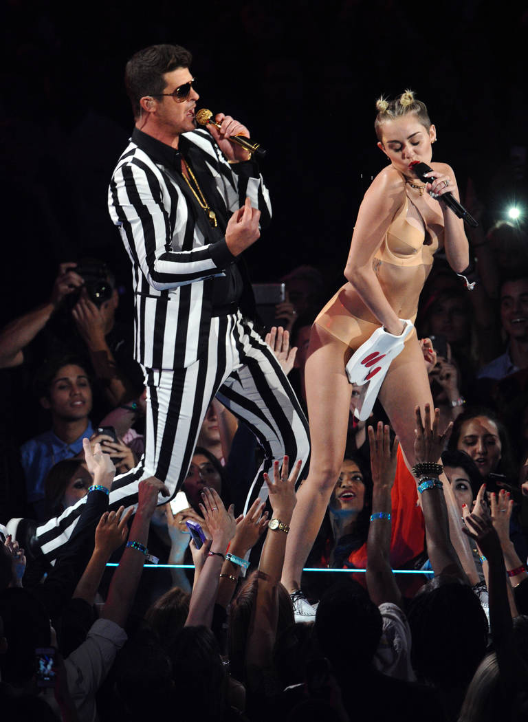 """Robin Thicke, left, and Miley Cyrus perform """"Blurred Lines"""" at the MTV Video Music Awards on Sunday, Aug. 25, 2013, at the Barclays Center in the Brooklyn borough of New York. (P ..."""