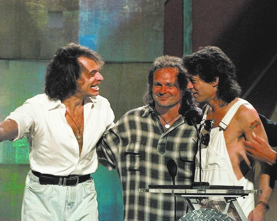 David Lee Roth, left, reunites with former bandmates Michael Anthony, center, and Eddie Van Halen at the MTV Video Music Awards in New York Wednesday, Sept. 4, 1996. (AP Photo/Bebeto Matthews)