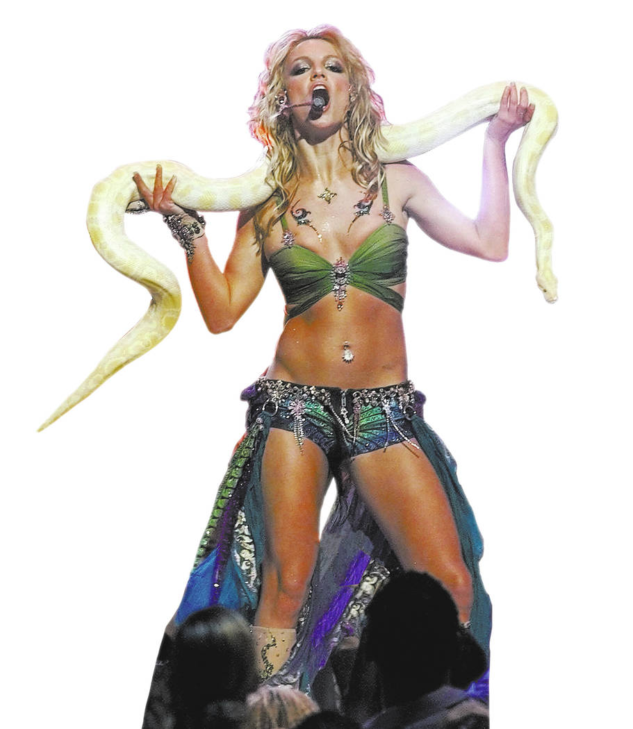 Britney Spears performs with a snake during the finale of the 2001 MTV Video Music Awards Thursday, Sept. 6, 2001, at New York's Metropolitan Opera House. (AP Photo/Beth A. Keiser)
