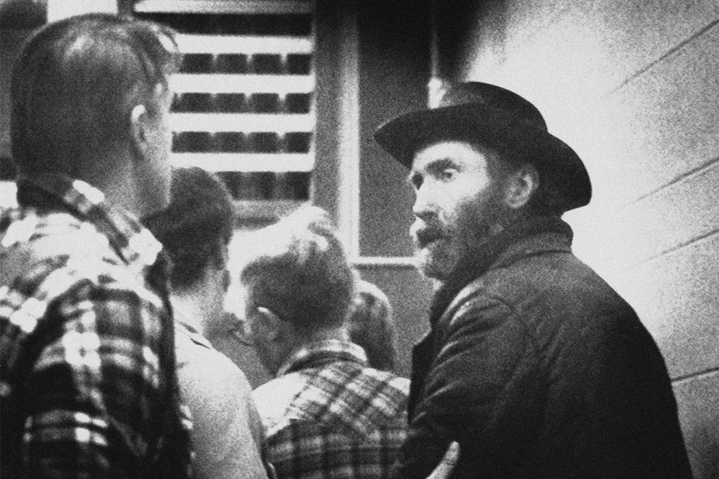 In this Dec. 14, 1984, file photo, Don Nichols is led into custody along with his son, Dan Nichols, after their capture near the Bear Trap Canyon about 30 miles west of Bozeman, Mont. Self-describ ...