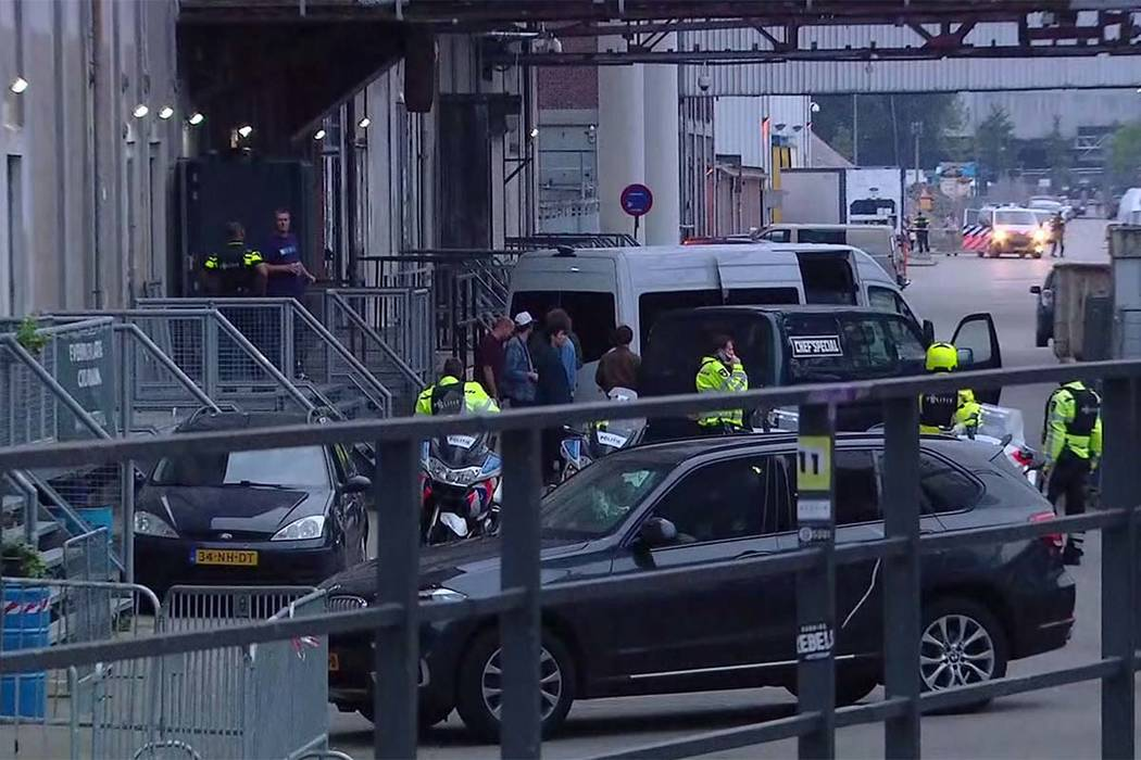 In this image taken from video, Dutch security stand around a van in Rotterdam, Wednesday Aug. 23, 2017, after a concert by an American rock band was canceled following a threat. (RTL via AP)