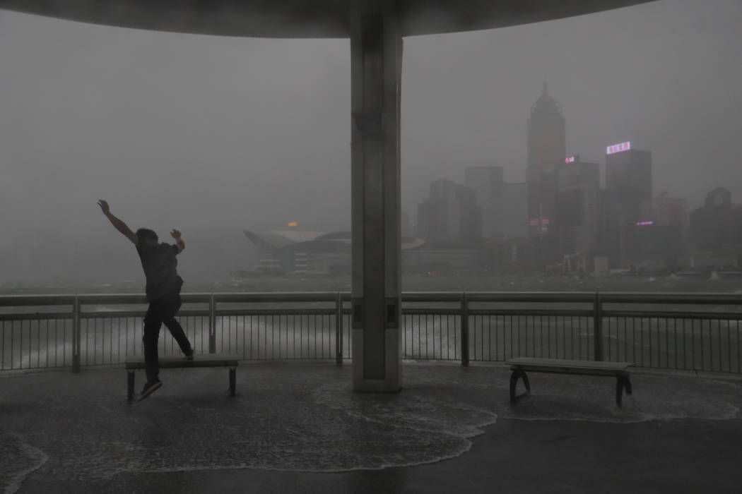 Strong wind caused by Typhoon Hato on the waterfront of Victoria Habour in Hong Kong, Wednesday, Aug. 23, 2017. The powerful typhoon barreled into Hong Kong on Wednesday, forcing offices and schoo ...