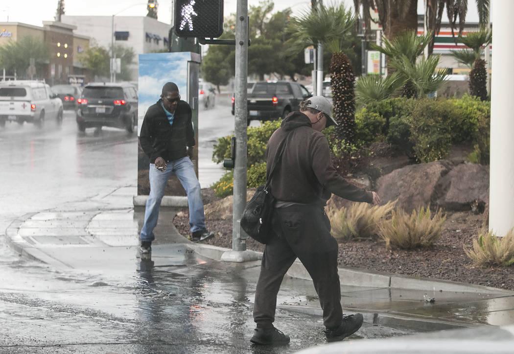 Pedestrian walk along Lake Mead Boulevard after a heavy rainfall in Las Vegas on Thursday, Aug. 24, 2017. (Bizuayehu Tesfaye/Las Vegas Review-Journal) @bizutesfaye