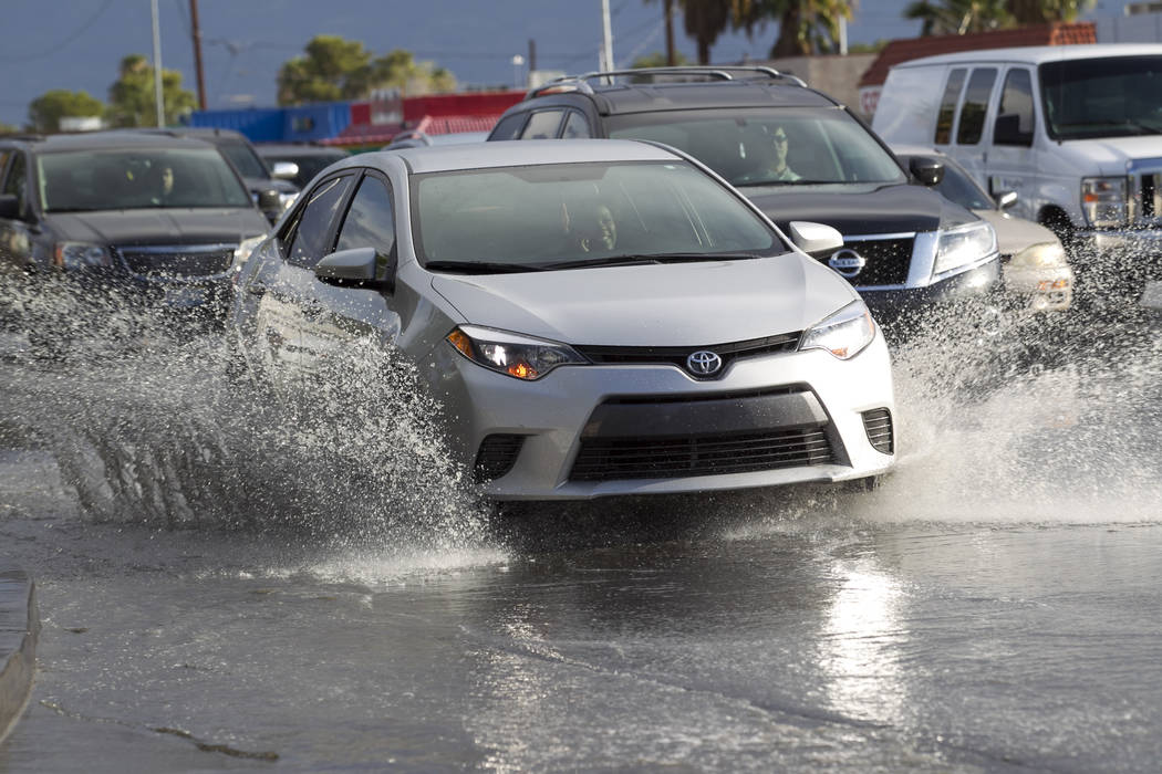 Motorists drive through the flooded intersection of South Decatur Boulevard and West Charleston Boulevard in Las Vegas on Thursday, Aug. 24, 2017. (Richard Brian/Las Vegas Review-Journal) @vegasph ...