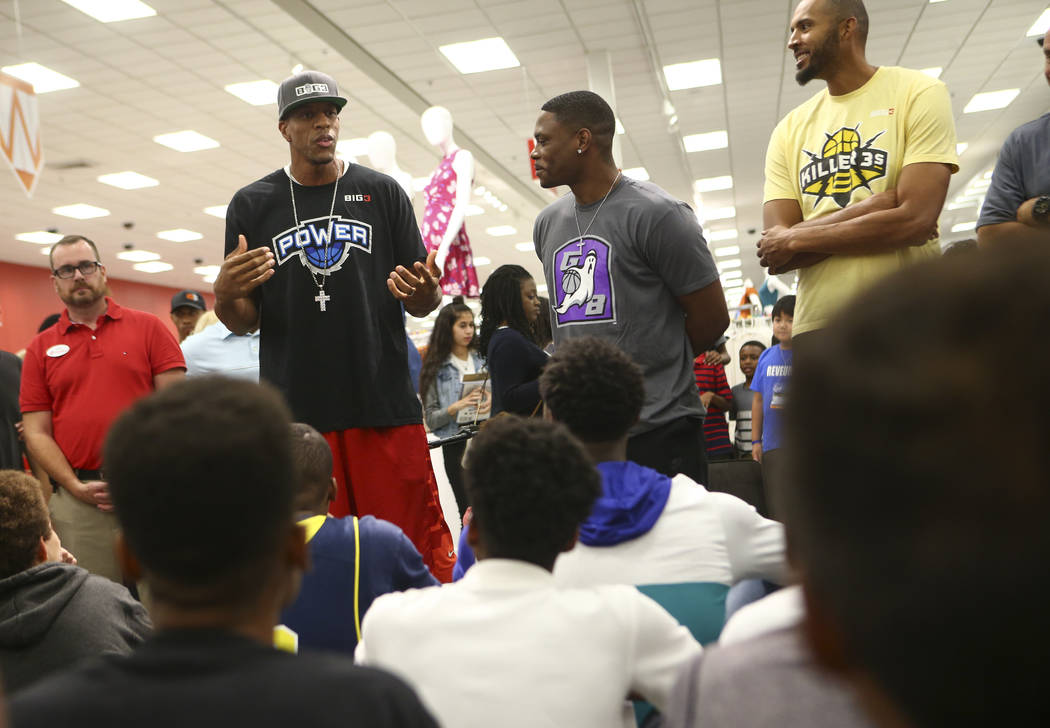 Former NBA players Jerome Williams, from left, Marcus Banks and Brian Cook, all players in the Big 3 basketball league, during an event held by the Nevada Partnership for Homeless Youth and the Bi ...