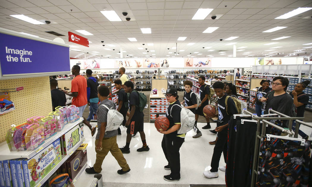 Players in the Big 3 basketball league help homeless children and young adults shop during an event held by the Nevada Partnership for Homeless Youth and the Big 3 at Target, 8750 W. Charleston Bl ...