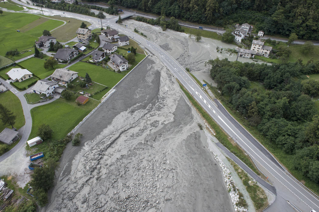 This photo taken Wednesday, Aug. 23, 2017 shows a landslide that hit the village Bondo in southern Switzerland. (Giancarlo Cattaneo/Keystone via AP)