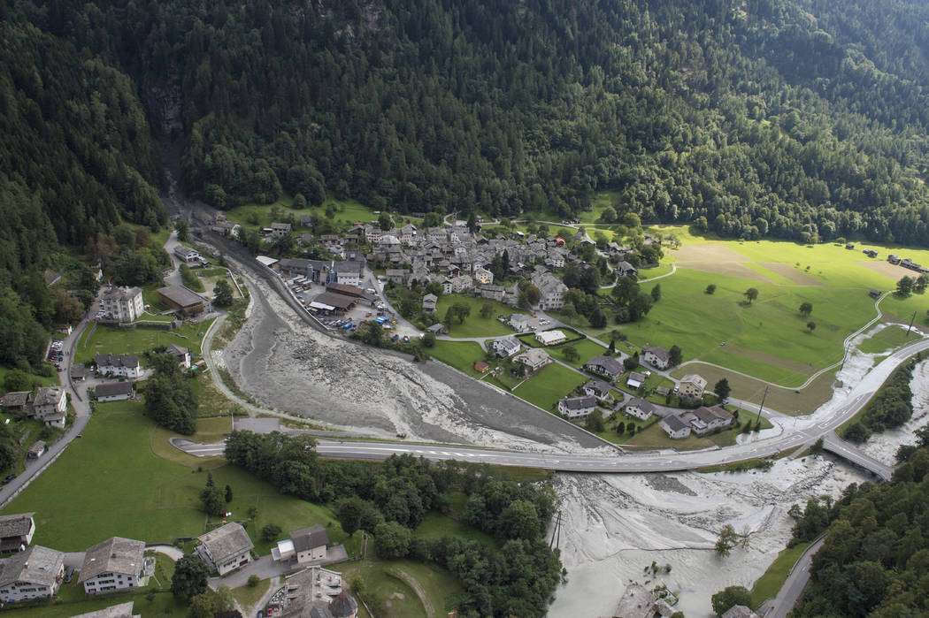 This photo taken Wednesday, Aug. 23, 2017 shows a landslide that hit the village Bondo in southern Switzerland. Police say eight people remain missing a day after mud- and rockslides swept through ...