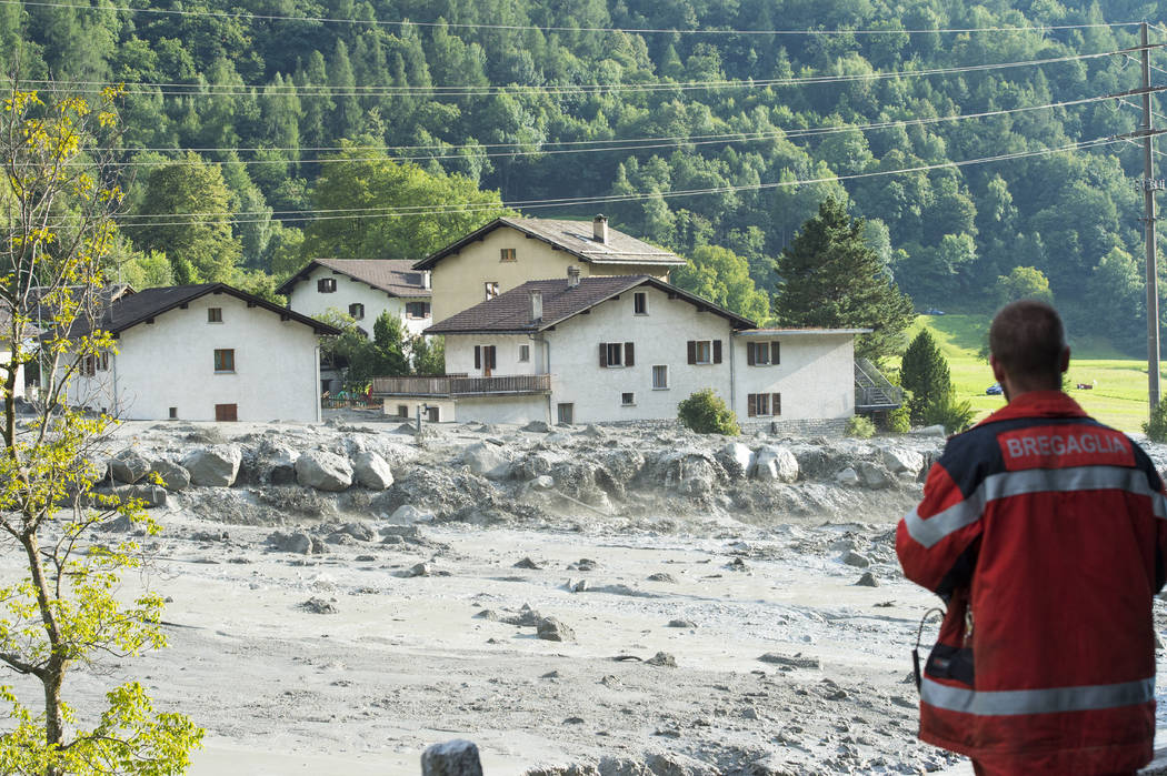 A landslide that hit the village Bondo in southern Switzerland, Wednesday, Aug. 23, 2017. Police said Thursday, Aug. 24, 2017, eight people remain missing a day after mud- and rockslides swept thr ...