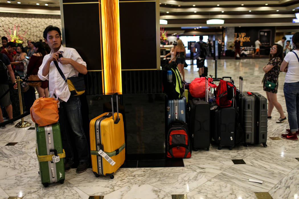 A guest stands in the MGM Grand lobby as people check in to their hotel rooms in Las Vegas on Aug. 24, 2017. Joel Angel Juarez Las Vegas Review-Journal @jajuarezphoto