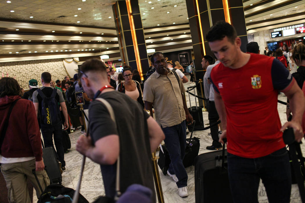 People gather at the MGM Grand lobby as they check in to their hotel rooms in Las Vegas on Aug. 24, 2017. Joel Angel Juarez Las Vegas Review-Journal @jajuarezphoto