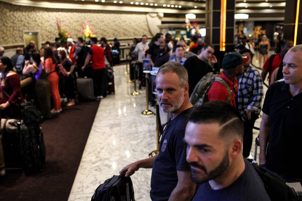 Mark Scholler of Australia waits in line to check in to his hotel room at the MGM Grand in Las Vegas on Aug. 24, 2017. Joel Angel Juarez Las Vegas Review-Journal @jajuarezphoto