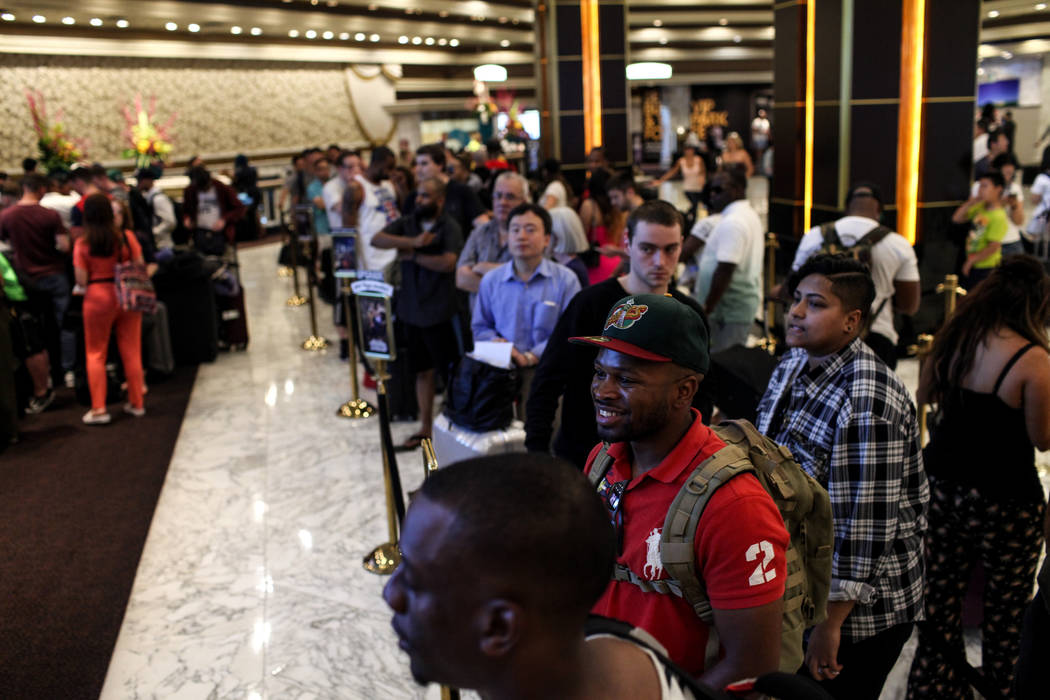 Guests gather at the MGM Grand lobby as they wait to check in to their hotel rooms in Las Vegas on Aug. 24, 2017. Joel Angel Juarez Las Vegas Review-Journal @jajuarezphoto