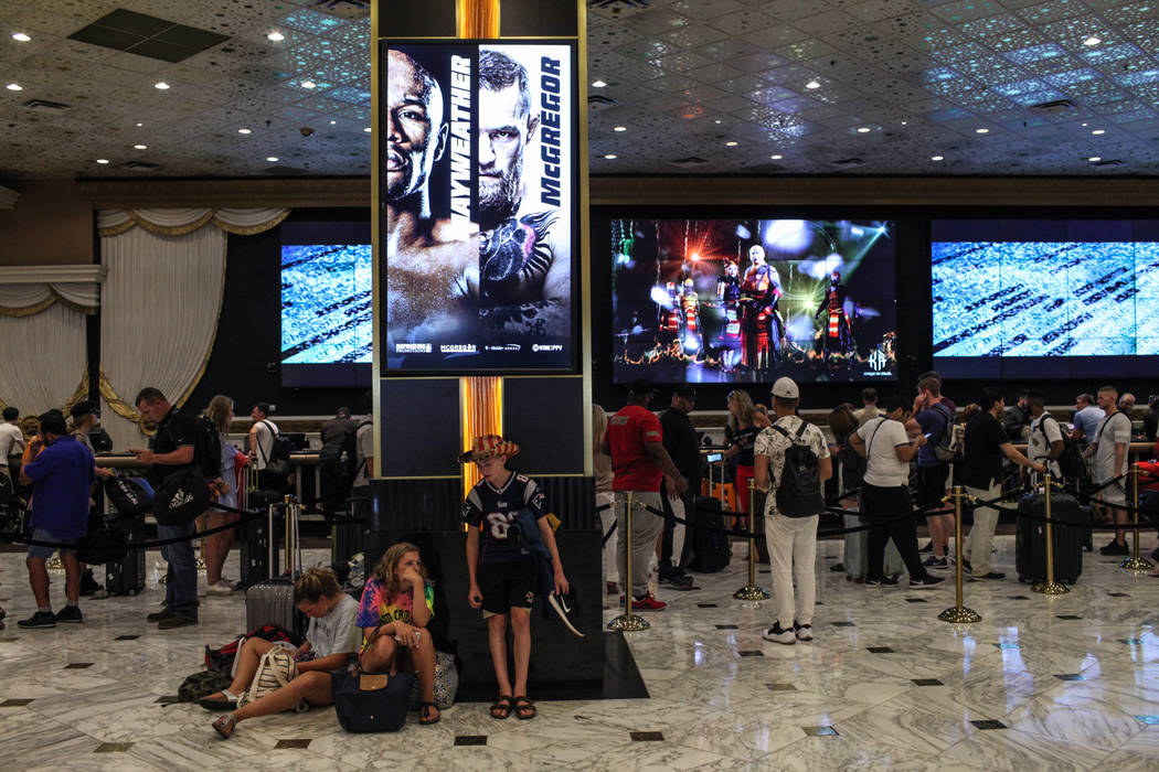 Grace Pomeroy, 14, Anna Pomeroy, 16, and Henry Pomeroy, 13, wait in the MGM Grand lobby as their parents check in to their hotel room in Las Vegas on Aug. 24, 2017. Joel Angel Juarez Las Vegas Rev ...