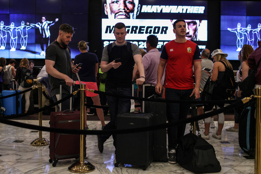 Noall Mallon, Sean Doyle and Alan Moore of Dublin, Ireland wait in line to check into their hotel rooms at the MGM Grand in Las Vegas on Aug. 24, 2017. Joel Angel Juarez Las Vegas Review-Journal @ ...