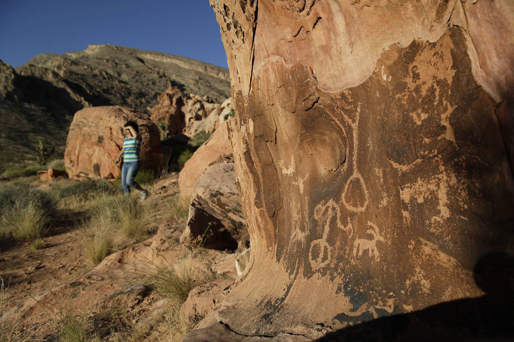 Susie Gelbart walks near petroglyphs at the Gold Butte National Monument near Bunkerville, May 26, 2017. Interior Secretary Ryan Zinke said he's recommending that none of 27 national monuments car ...