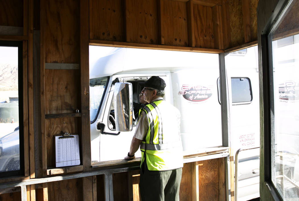 George Mohsen, inspector, watches as a tractor trailer passes through the California agricultural inspection station Friday, Aug. 25, 2017, on Interstate 15 in Yermo. (Bizuayehu Tesfaye/Las Vegas  ...