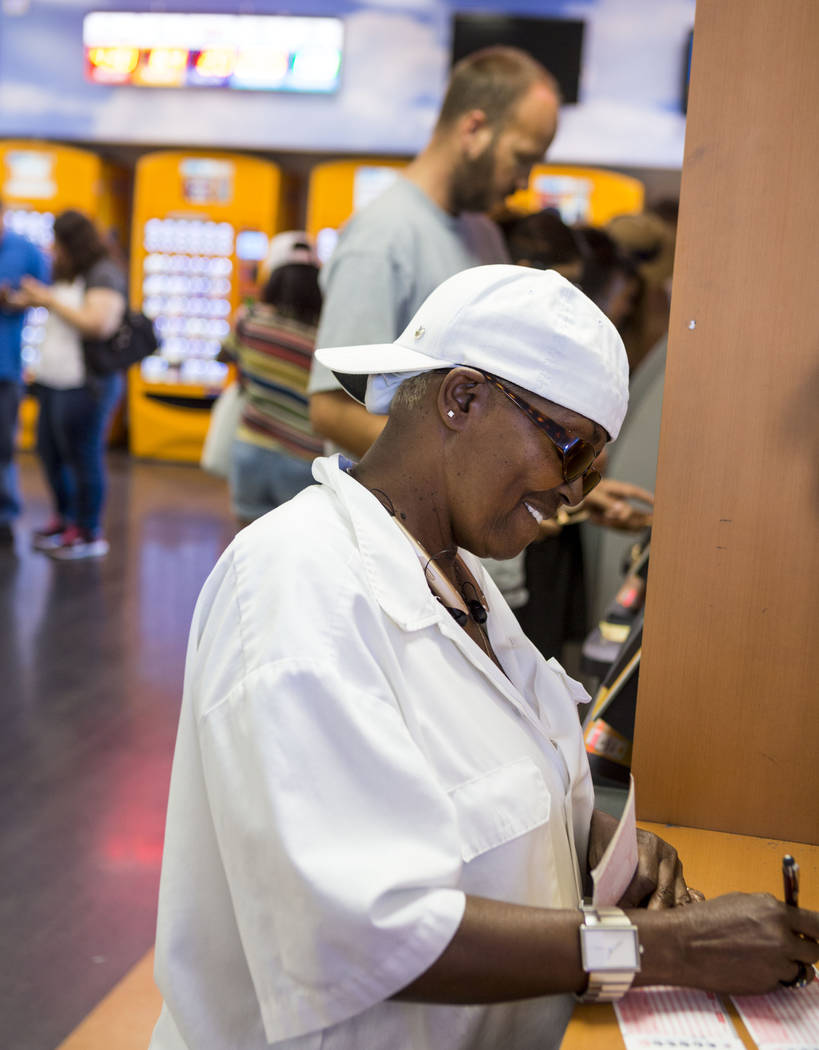 Augusta Scott fills out numbers on Powerball tickets at the Primm Valley Lotto Store located at 31900 S. Las Vegas Blvd., which is a few feet west of the Nevada-California stateline and technicall ...