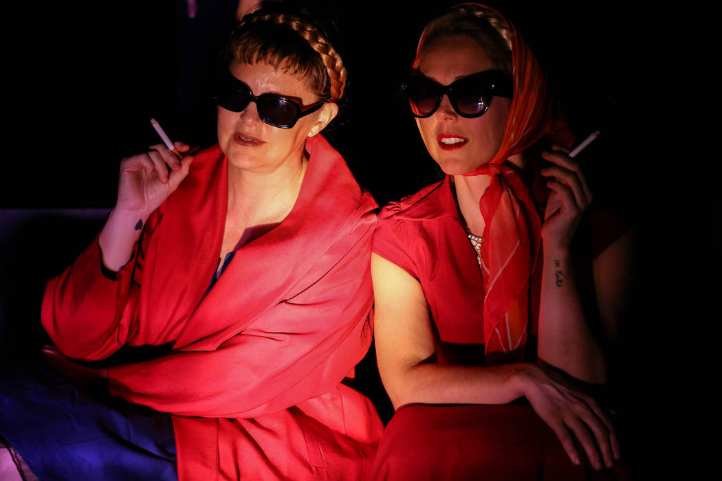 "Dina Emerson, left, and Anastasia Weiss, right, hold cigarettes during a rehearsal of ""The Seven Deadly Sins"" at the Art Square Theatre in Las Vegas on Aug. 28, 2017. Joel Angel  ..."