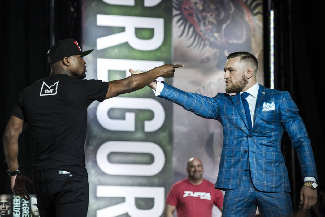 Floyd Mayweather, left, and Conor McGregor exchange harsh words during a promotional stop in Toronto on Wednesday, July 12, 2017, for their upcoming boxing match in Las Vegas. (Christopher Katsaro ...